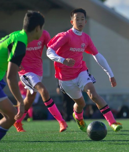 Senior David Yoon runs up the field while playing soccer for his Herndon based travel team.