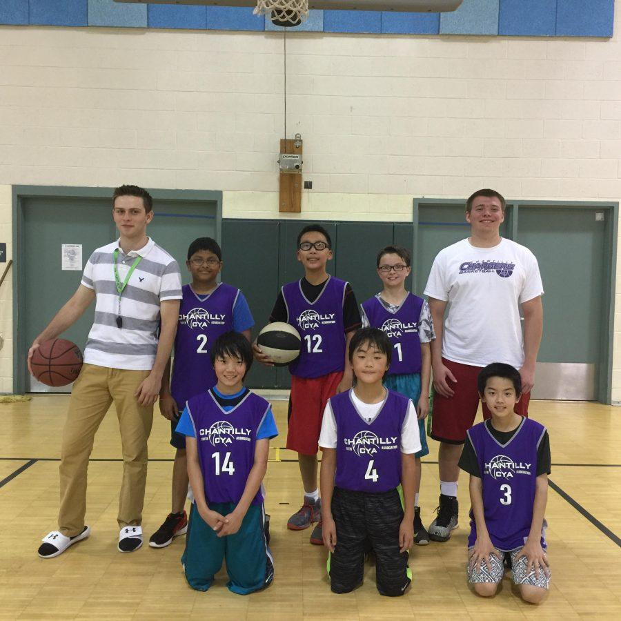 Seniors+Michael+Shepherd+and+John+Hiemstra+pose+after+a+game+with+their+CYA+basketball+team.