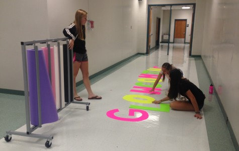 Students in Leadership work to create posters and props for homecoming week.