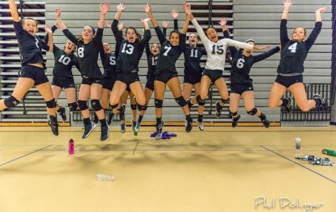 Volleyball team has some fun with their pictures not worrying about always being serious.