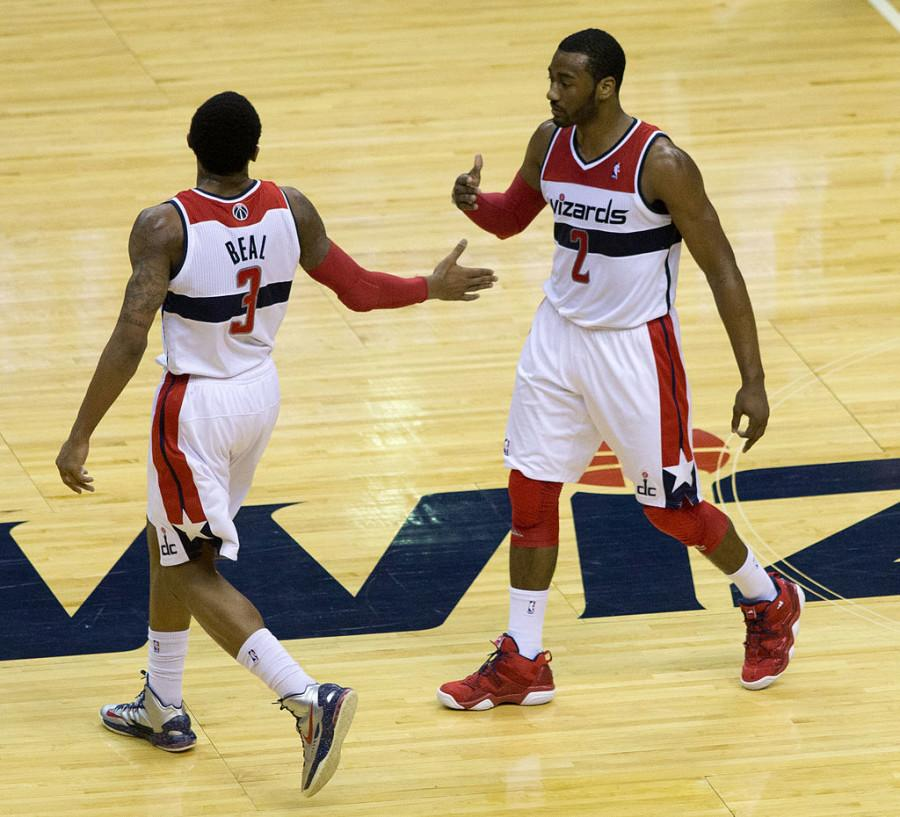Wizards' guards  John Wall and Bradley Beal exchange a high five during a game.