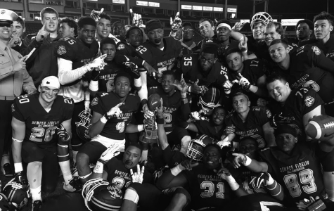 Sparks and his teammates celebrating after winning the Semper Fi Bowl.