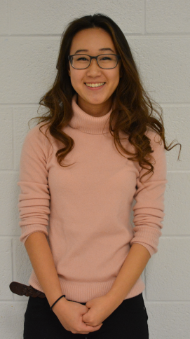 Senior Michelle Kim sports a fashionable pink turtleneck, one of the trends of this winter season.
