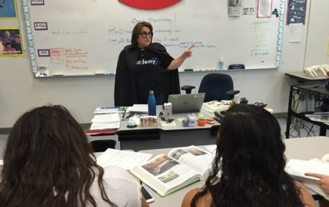 Jennifer Howe teaches her Dental Careers class, all while dressed up as a professor during Homecoming week