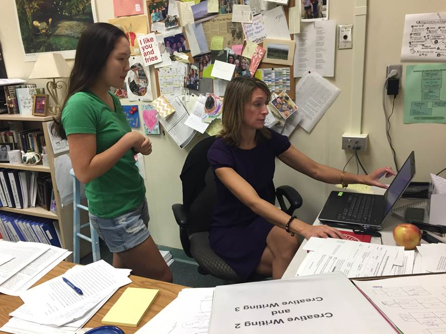 Junior Jennifer Cheung and teacher sponsor Nikki Lehman discuss strategies for new tutors.