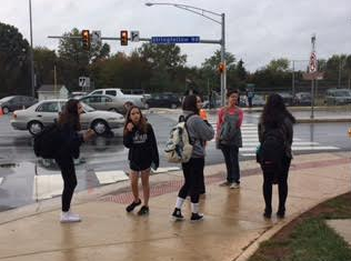 Students impatiently wait to cross Stringfellow Road to get to their cars after school.