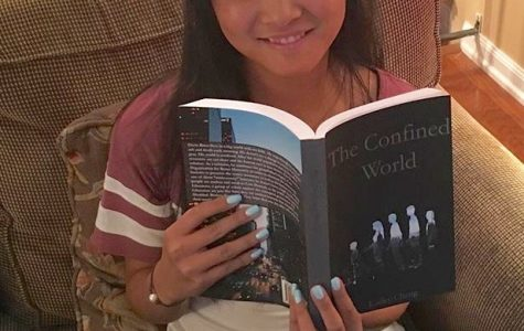 Senior Kailey Cheng poses with her newly published book,