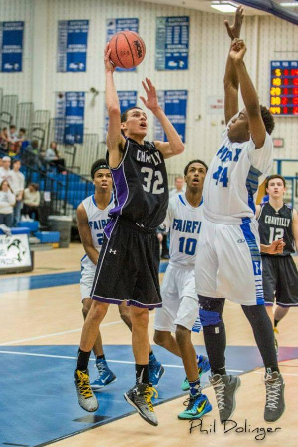 Senior Forward Elijah Ford attempts a shot during a game against Fairfax High School.