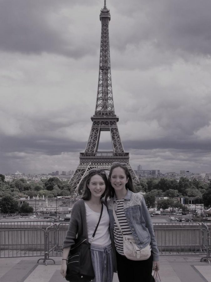 Senior Becca Pierce and former Chantilly junior Hannah Snarr pose in front of the Eiffel Tower.