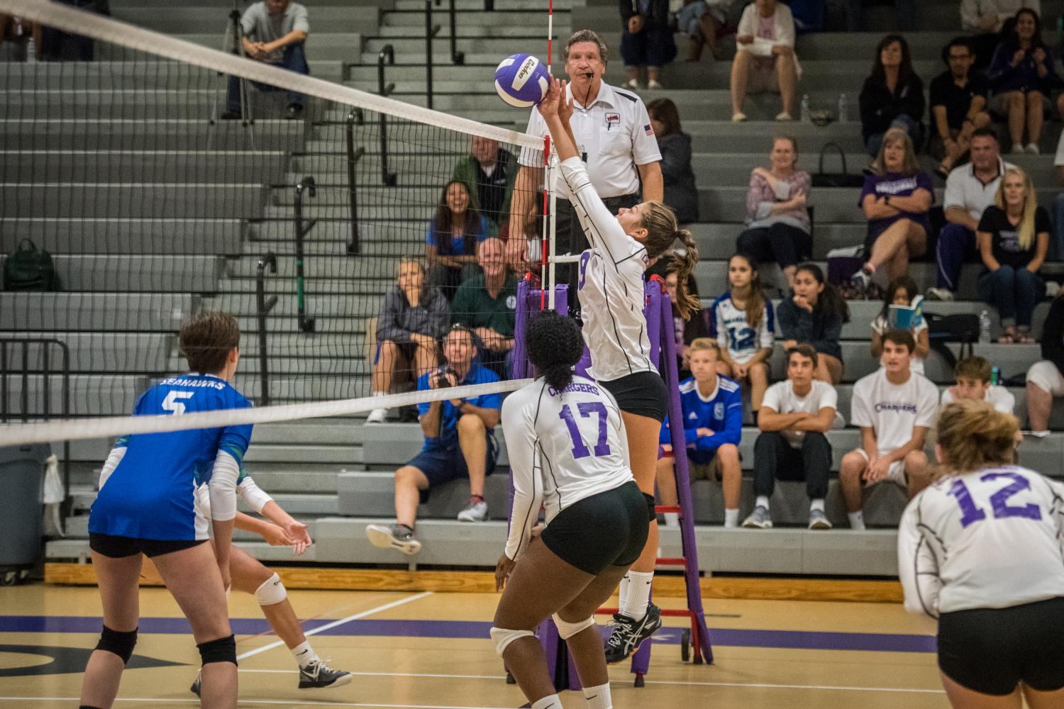 After receiving a set from junior Mujay Mambu, freshman Gabi Axelrod earns a point for Chantilly during the game against Westfield.