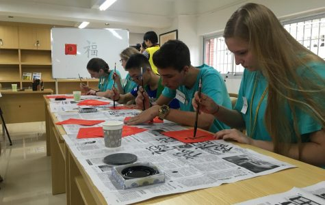 Junior Celie Feighery practices writing Chinese characters during her recent trip to China.