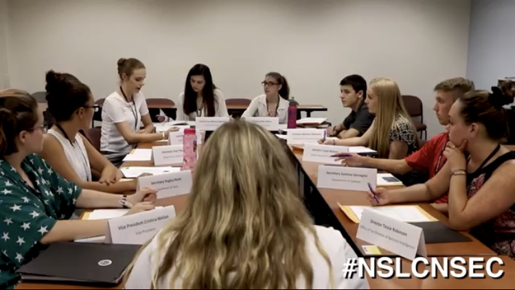 Sophomore Eva William, third from left, participates in a National Security Council simulation as part of the National Student Leadership Conference at American University over the summer.