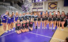 Chantilly varsity cheerleaders pose with their competitors following their legendary Districts win.