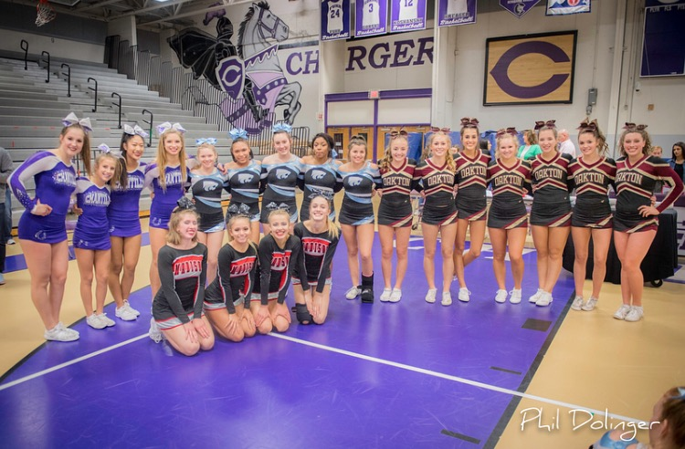 Chantilly+varsity+cheerleaders+pose+with+their+competitors+following+their+legendary+Districts+win.