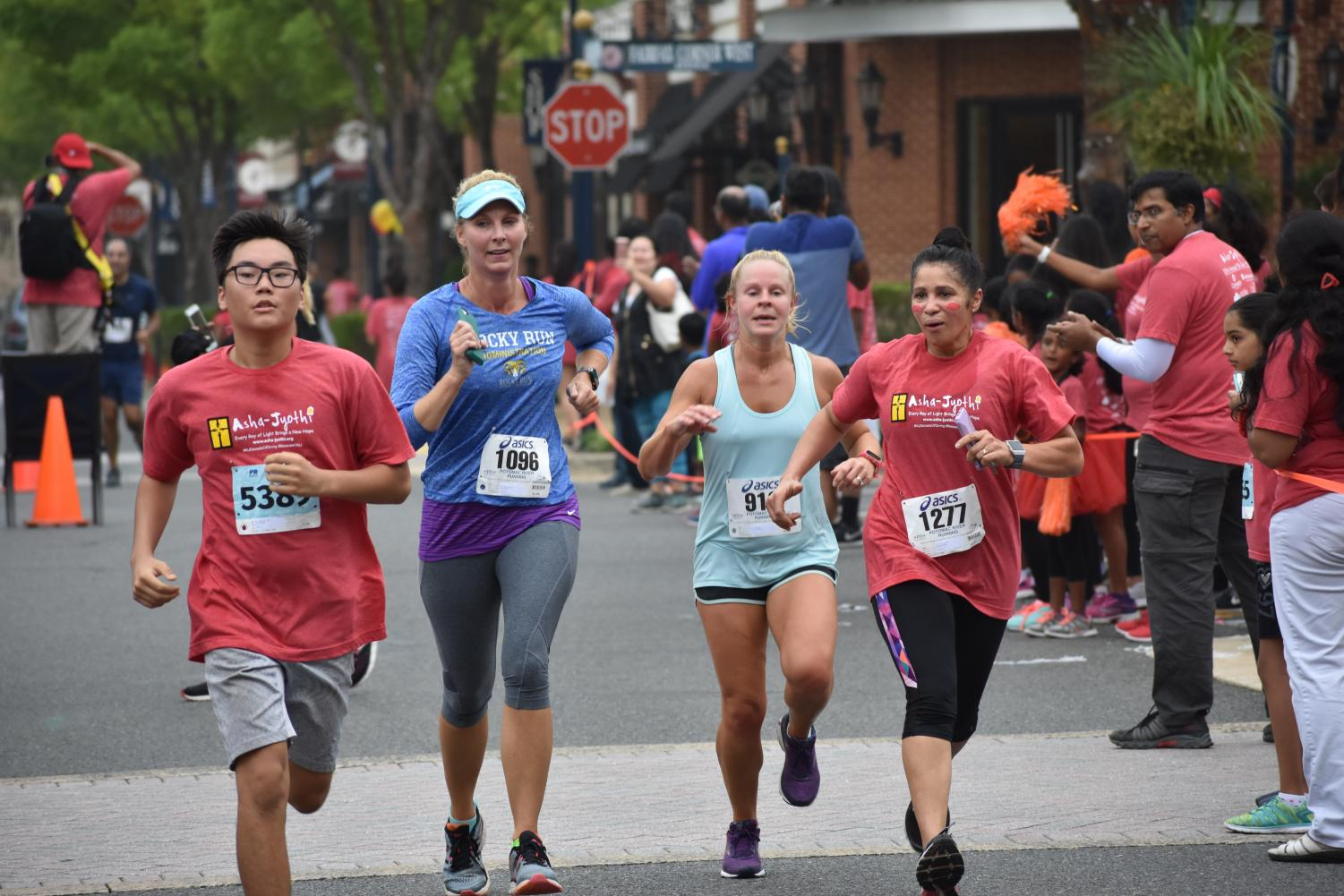 Sophomore Arnold Chinbat, Rocky Run Principal Amy Goodloe, Rocky Run English teacher Jeannine Magwire and Spanish teacher Zoraida Vazquez run for a cause at the Asha-Jyothi 5K.