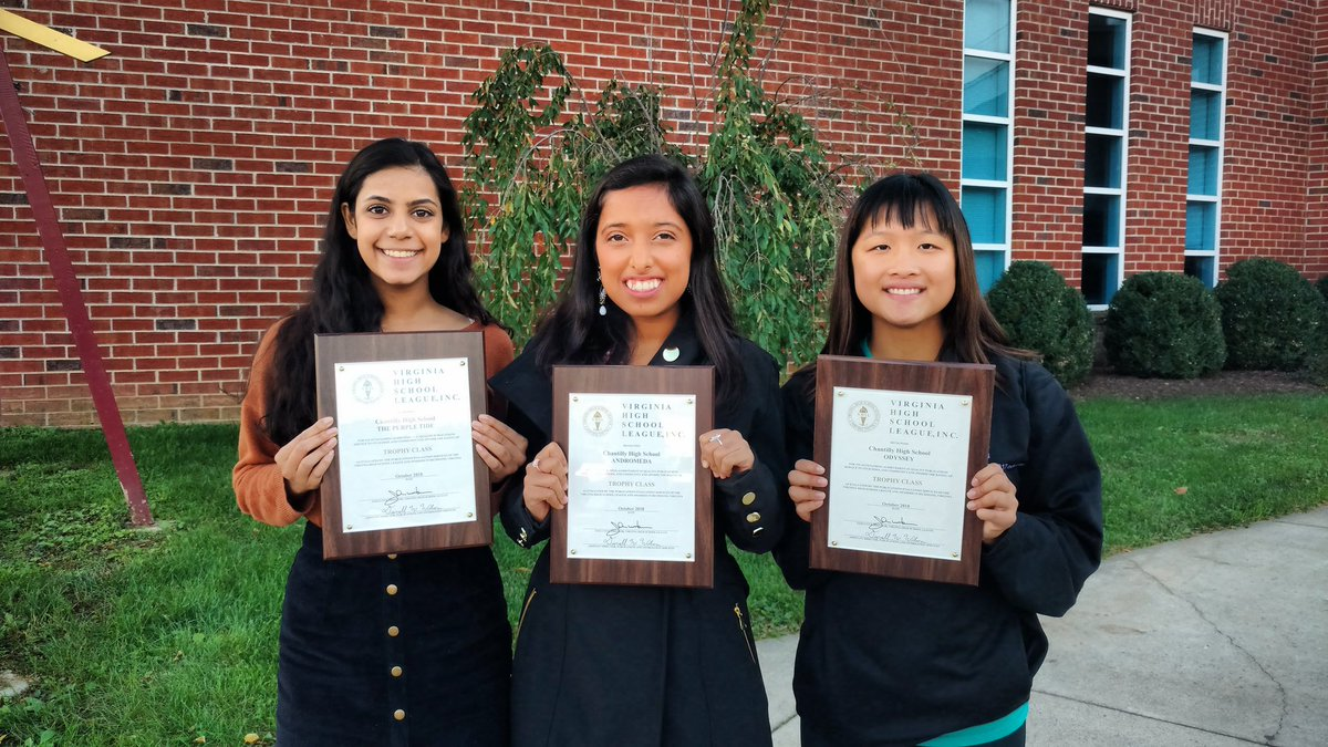 Seniors Priya Viswanathan and Kat Sharma and junior Julia Cheng pose with their programs' awards at the event.