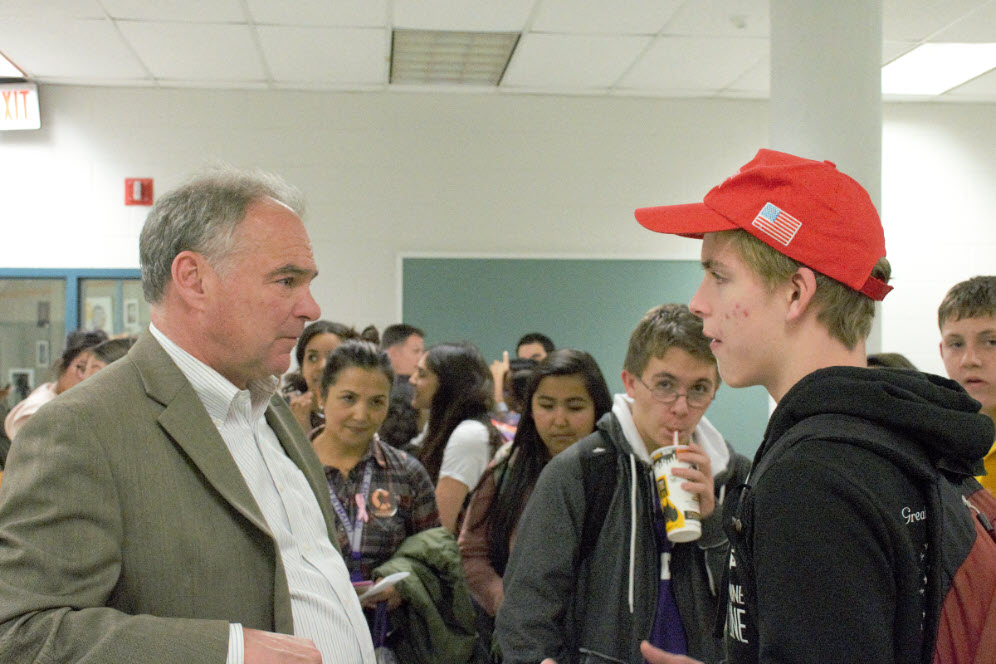 Senator Tim Kaine listens to a student's concerns while visiting Chantilly to speak and connect with the school community.