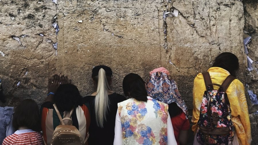 """During the summer of 2017, I went to Israel for five weeks with a group, and we went to the western wall. I took my picture there of the women praying against the wall and putting their notes to God on it because it seemed to convey powerful emotion and faith."""