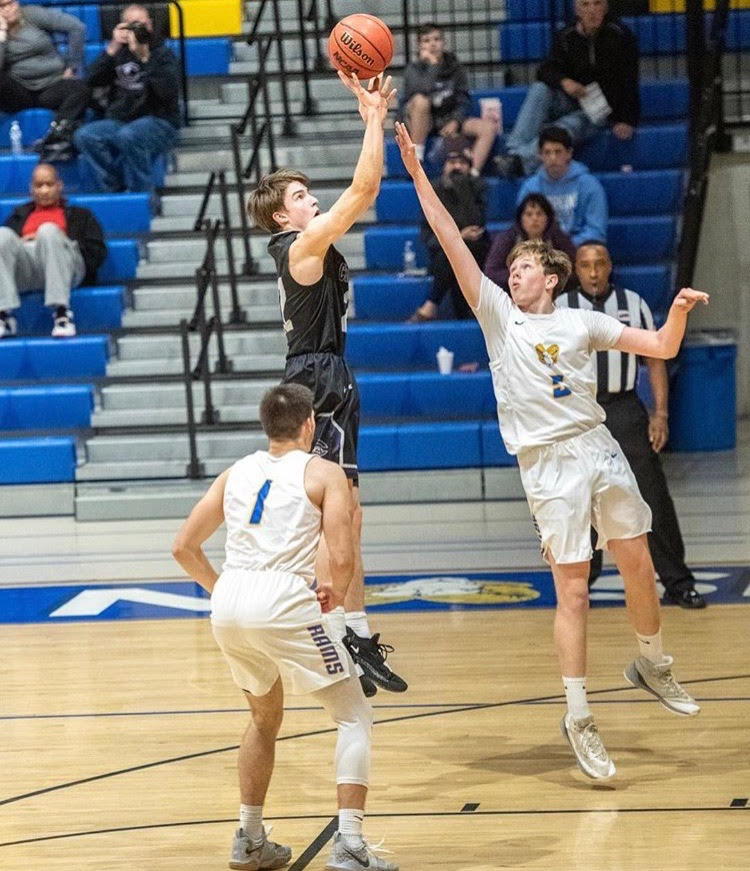 Junior and varsity shooting guard Chris Miers shoots a jump shot in the game against Robinson on Dec. 4.