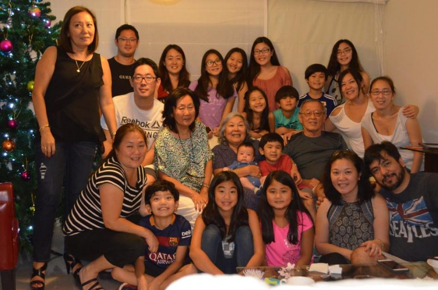 Freshman+Paula+Muente-Mizushima+and+junior+Alessandra+Tazoe+pose+in+a+family+picture+at+their+grandparents%27+home+during+a+winter+break+trip+to+Peru+in+2016.