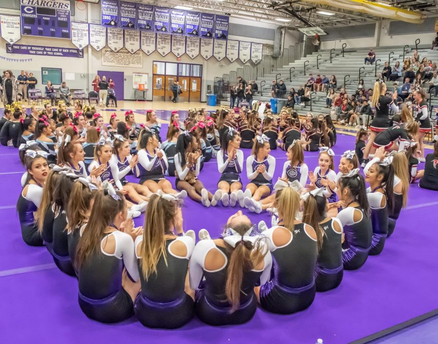 Varsity cheer waits for the results of the district championship competition. The team placed second in both the district and the region.