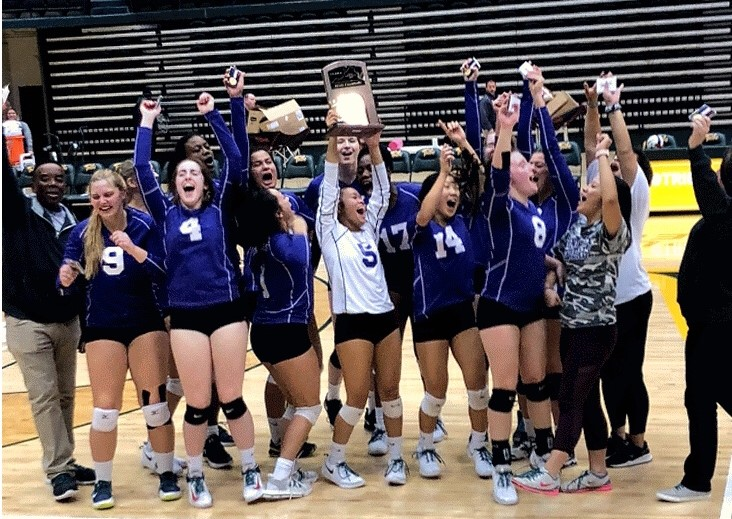 Varsity volleyball celebrates its state championship win over Cox on Nov. 16. The team competed at the College of William & Mary, with many students attending to cheer on the team.