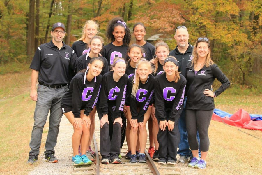 The varsity girls' cross country team poses for a photo before the district meet. The team went on to win the district title for the first time since 1999 before winning third in the region.