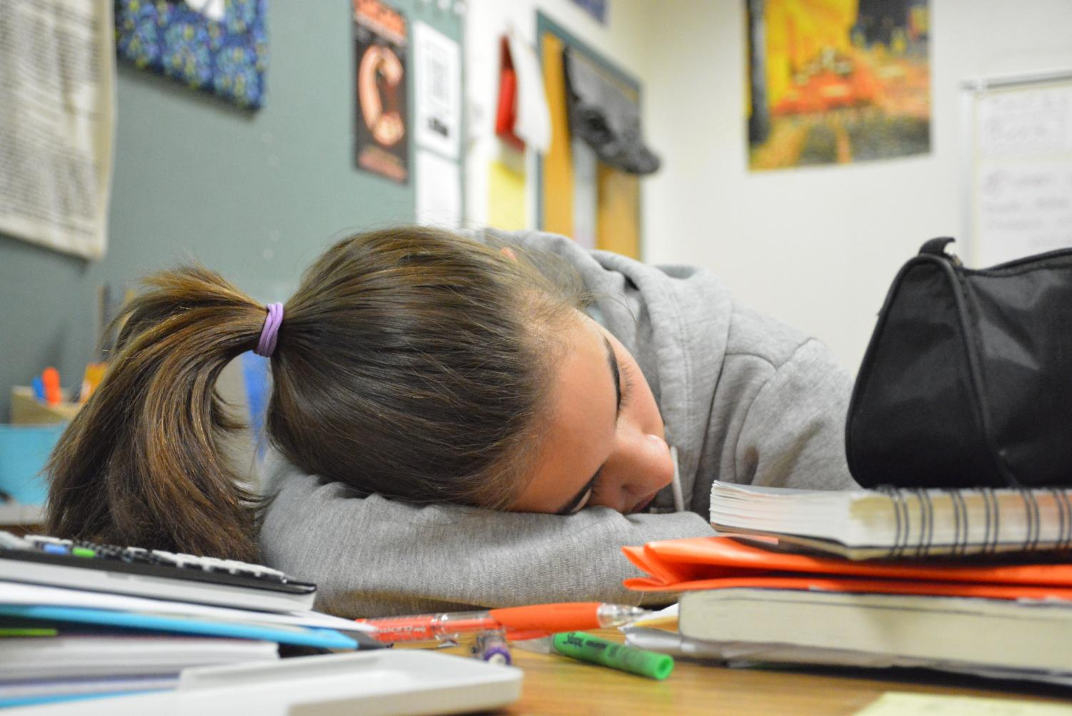 This photo depicts a student sleeping in school in order to highlight the everyday reality for many students who spend countless hours each night doing homework, leaving little time for much needed sleep.