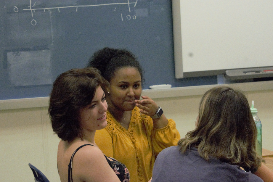 Seniors Lily Black, Jordan Hundley, and Bezawit Abraha engage in a warm-up discussion in Political Science.