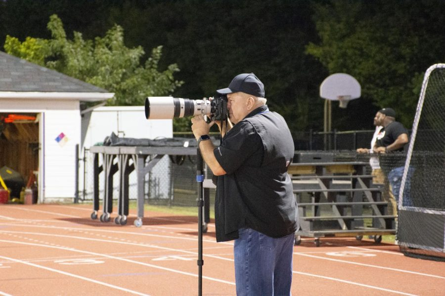 Phil Dolinger particpates in usual Friday night football game by taking pictures for the players and community. Phil enjoys spending his time capturing memorable moments for athletes.
