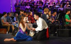 Senior Haley Herman (left) as Ariel and senior Jun Ito (right) as Prince Eric act out scenes from Disneys The Little Mermaid as the band plays the melodies during their dress rehearsal.