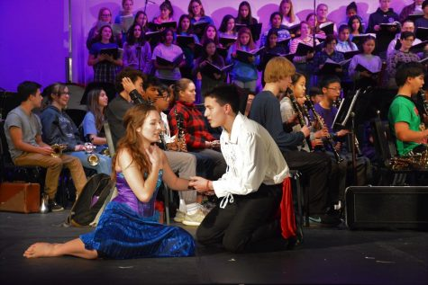 Senior Haley Herman (left) as Ariel and senior Jun Ito (right) as Prince Eric act out scenes from Disney