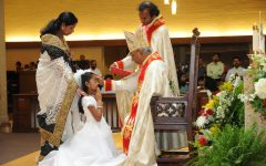 This photo depicts Nayana Celine Xavier getting confirmed on her First Holy Communion and Confirmation day. Communion and Confirmation mark an individual's acceptance of Christianity, a religion that offers a sense of strength and guidance in Celine Xavier's life.
