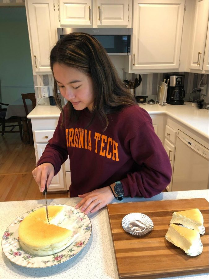 Here's me cutting up yet another cheesecake that I made. It's the third one since quarantine has started, but I doubt anyone in my family is complaining.