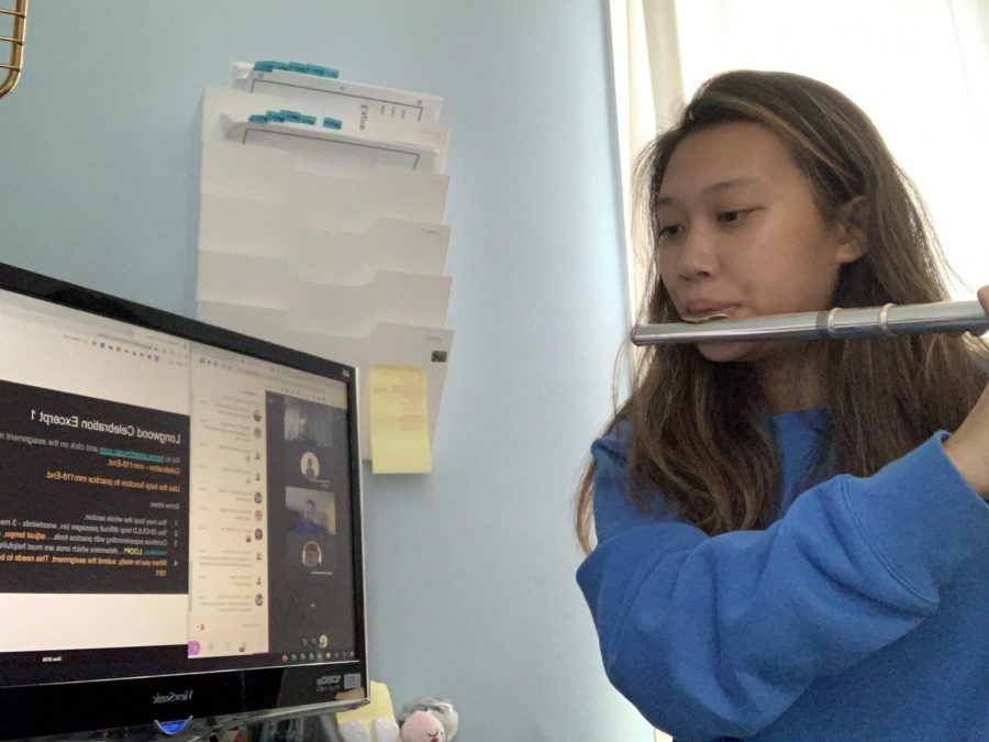 "Sophomore Jocelyn Cheung practices symphonic band's group piece, ""Longwood Celebration,"" on the flute during class on October 1."