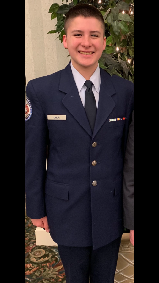 Junior Austin Uhlir poses at the annual JROTC Dining event on January 25, 2019.