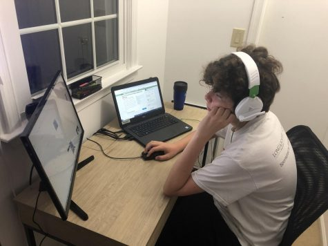 Freshman John Chernisky works from home at his designated learning space in order to focus during class.