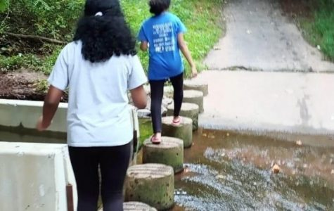 Junior Sheona Jerin explores a trail with her sister on Aug. 20 near a friend's house. Quarantine has opened up space for many to spend time in nature and with family.