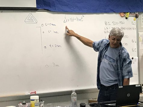 Science teacher Patrick Matalavage demonstrates a physics problem on the white board during seventh period on October 1.