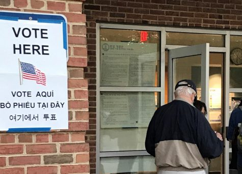 People enter an early voting station in Falls Church on Oct. 14.