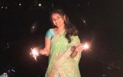 Sophomore Gayatri Dhavala holds firecrackers as she celebrates Diwali with her family.