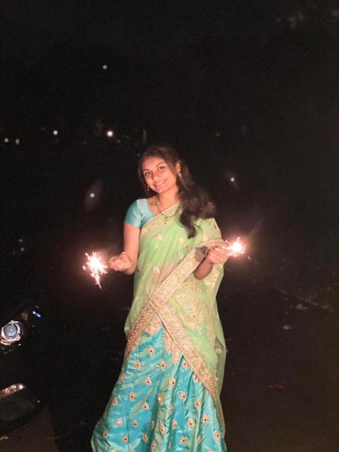 Sophomore+Gayatri+Dhavala+holds+firecrackers+as+she+celebrates+Diwali+with+her+family.