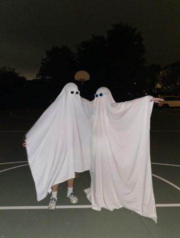 Freshman Linda Gu dresses up as a ghost with a friend on Sept. 27.