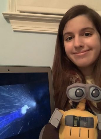 "Sophomore Anna Dimaiuta watches her favorite Disney move ""WALL-E"" with her own WALL-E."