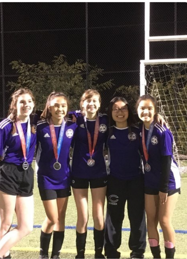 Junior Libby Bondi (center) and her friends celebrate the end of a successful 2019 soccer season.