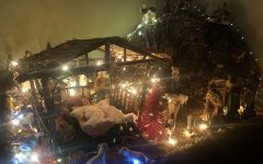 A Nativity scene made by Maria Eugenia, math teacher Cecilia Torres's aunt, to appreciate her religion, with wood, dolls and lights on the first week of December, celebrating Christmas in Peru.
