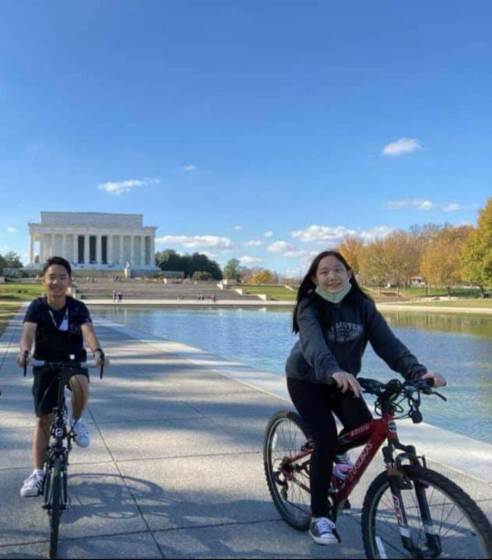 Freshman Paparda Tanadumrongsakd rides her bike in D.C.