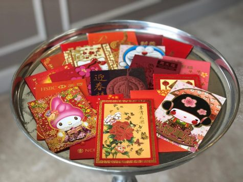 "Giving red envelopes, or 紅包, is also an important tradition during Chinese New Year. Relatives give kids these pockets that contain money. They come in many different shapes, sizes, designs and colors. Red envelopes also serve as congratulatory gifts at weddings or births. ""I call my grandparents in Taiwan [and get] red envelopes."" freshman Stephen Tsai said."