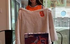 Junior Katherine Richer poses for a picture with Syracuse University gear ahead of this year's tournament.