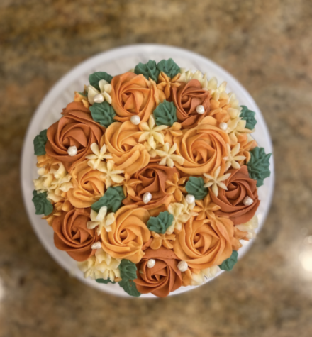 The photograph above pictures one of Namya Kohli's orders, a fall themed vanilla cake with hand piped floral decorations.